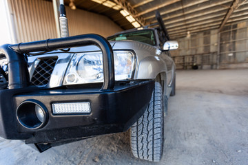 Headlight and bullbar closeup on four wheel drive truck