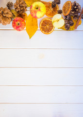 Cup with tea on an autumn background of fallen leaves, apples and grapes.Autumn postcard
