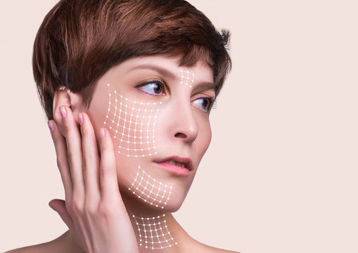 Close up of a portrait of a beautiful woman who wants to lift face to remove wrinkles and skin rejuvenation using anti wrinkle creams or surgery. Concept of thread lifting and surgery