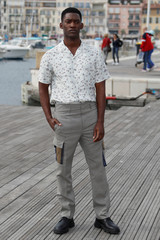 "Malachi Kirby poses during a photocall for the television series ""Curfew"" during the annual MIPCOM television programme market in Cannes"