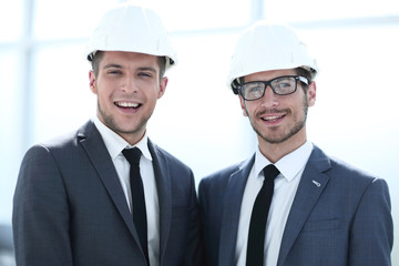 two builders are looking into the camera. concept of constructio