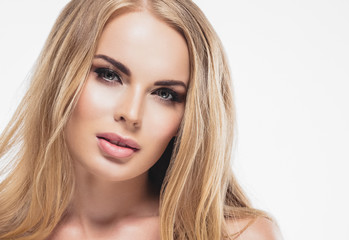 Blonde woman beautifu; eyes and makeup cosmetic concept beauty lips and hairstyle