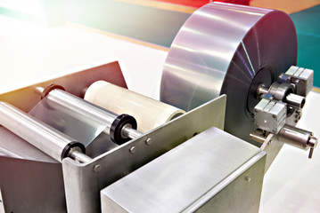 Roll of packaging film on machine food factory