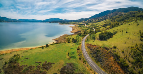 Road winding through lake shore and mountains. Scenic aerial panorama of Australia Wall mural