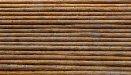Log wall. Background of wooden logs. Wood texture.