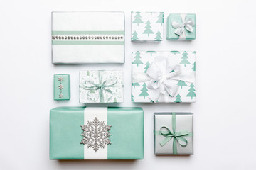 Beautiful nordic christmas gifts isolated on white background. Turquoise colored wrapped xmas boxes. Gift wrapping concept.