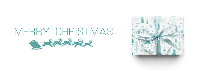 Christmas banner. Beautiful christmas gift isolated on white background. Turquoise colored wrapped xmas box. Gift wrapping concept.