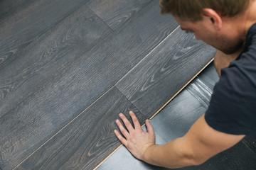 man installing laminate floor