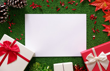top view of gift boxes on green grass background with white space for your text, Christmas decoration.
