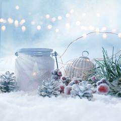 Winter still life in snow and golden bokeh