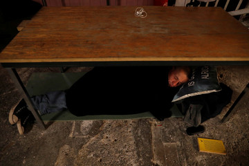 Homeless man sleeps at a shelter in Budapest