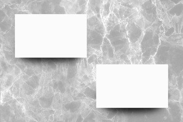 Empty white paper sheet on Grey marble background,Mock up for design.
