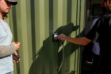 Students enter the shipping containers which house the marijuana lab at the new Commercial Cannabis Production Program in Niagara-On-The-Lake