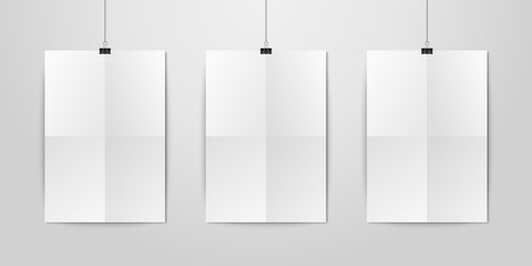 Three Vector Realistic White Blank Vertical A4 Folded Paper Poster Hanging on a Rope with Binder Clip Set on White Wall mock-up. Empty Poster Design Template for Graphics, Mockup