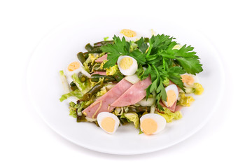 Salad of ham, green beans, lettuce and eggs