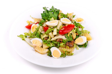 Salad of fried potatoes, eggs and lettuce