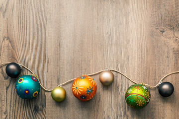 Christmas decoration glass balls on a wooden background