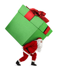 Santa Claus carrying huge christmas gift isolated on white background