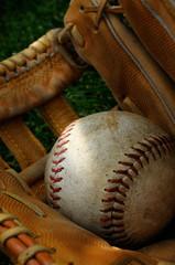 A Baseball Inside A Vintage Leather Baseball Glove