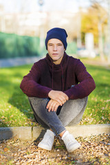 Portrait of a young male outdoors wearing casual attire