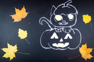 Halloween pumpkin on chalk Board