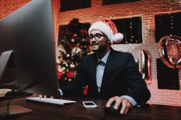 Businessman Playing on Computer on New Year Eve.