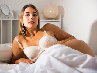 Foto op Canvas Akt Woman in lingerie lying in bed
