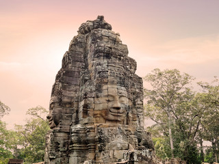 Ancient stone faces of Bayon temple in Angkor Thom, Siemreap, Cambodia.