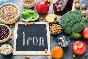 Fruits, vegetables, legumes, nuts and liver with high iron content. Food with iron. View from above. Place for text.
