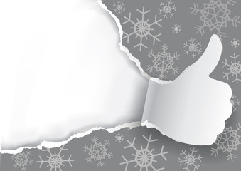 Thumbs up with Christmas torn paper background. 