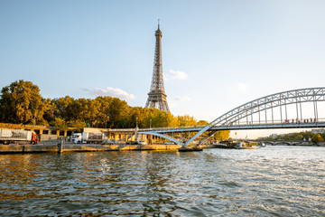 View on the Eiffel tower from the boat during the sunset in Paris