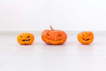 Halloween pumpkins. Funny Jack O'Lantern on the light room
