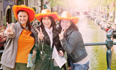 tourists in Amsterdam to celebrate the queen's day