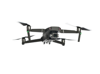 New dark grey drone quadcopter with digital camera and sensors flying isolated on white