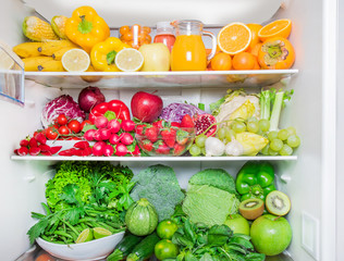 full fridge with vegetables and fruit. Healthy food concept
