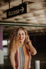 Beautiful curly woman with red lips