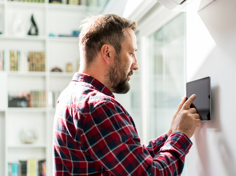 Man using smart home device