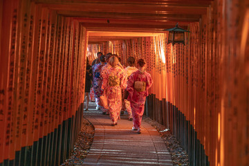 Girls walkin Fushimi Inari Shrine on Geisha attire