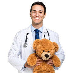 Handsome young pediatrician portrait holding a teddy bear