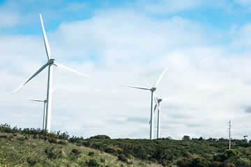 Wind farms or windmills for the extraction of wind power in Portugal. Ecological fuel or energy.