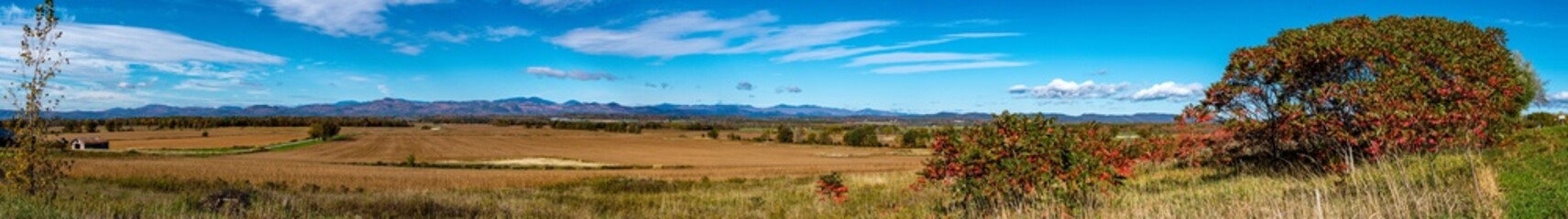 Panoramic view of a Vermont valley with the Adirondack Mountains in the background