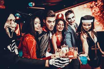 Friends in Halloween Costumes Drinking Cocktails Wall mural