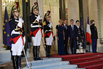 French President Emmanuel Macron and his wife Brigitte Macron greet South Korean President Moon Jae-in and his wife Kim Jung-sook before a dinner at the Elysee Palace in Paris