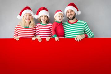 Family holding cardboard banner blank