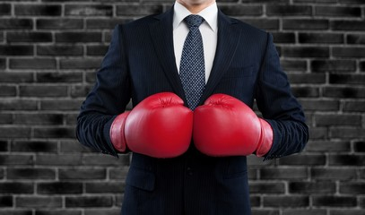 Business man in suit with red boxing