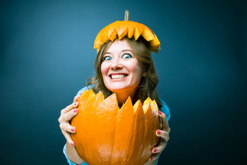 Portrait of beautiful cheerful woman with pumpkin Thanksgiving day