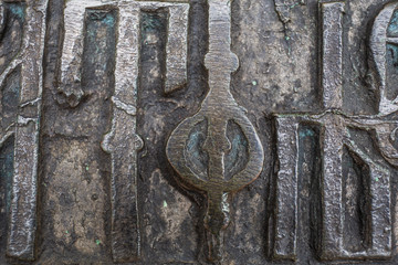 Close-up of ancient Slavic letters on ancient bronze bell in orthodox church in Rostov the Great