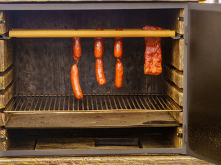 Smoked sausages meat hanging in smokehouse