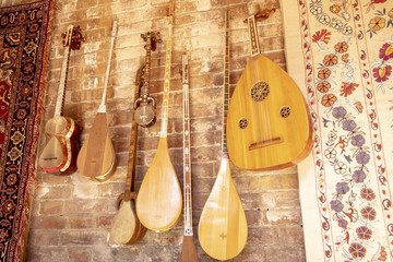 Traditional Suzani tapestry and musical instruments , Uzbekistan