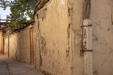 Old wall and door in alley Old Town Tashkent, Uzbekistan